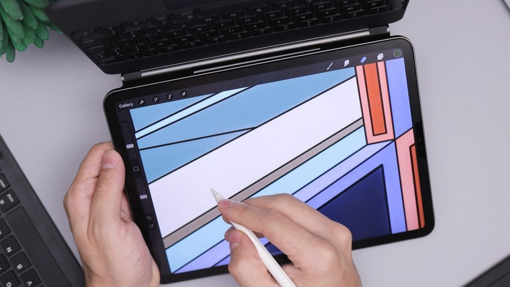 Person drawing on tablet