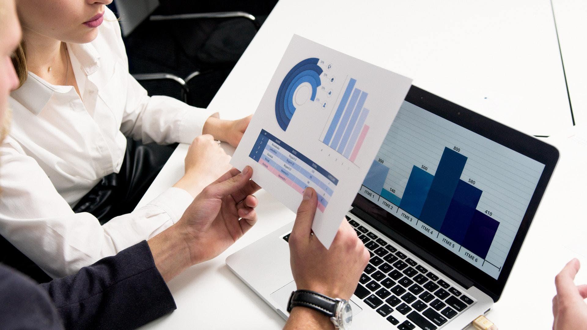 Man and woman looking at charts