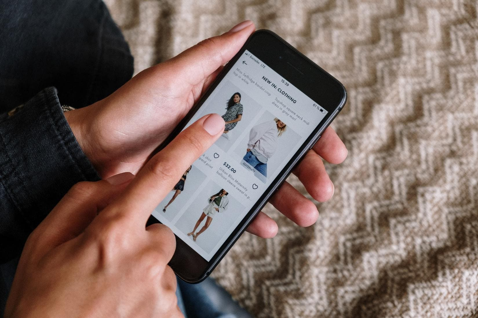 Woman online shopping on phone