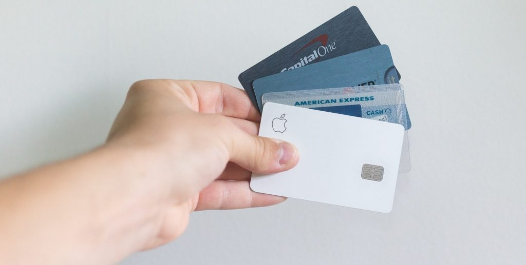 Person holding creadit cards